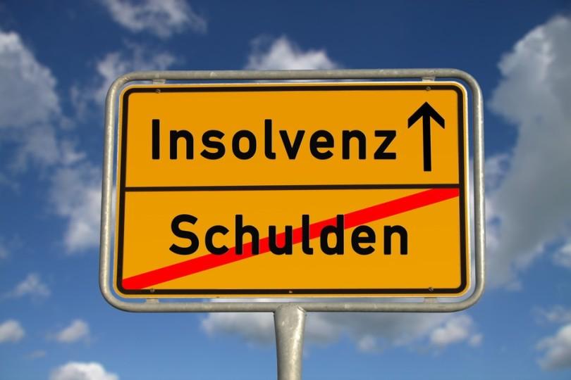 photodune-2498861-german-road-sign-debt-and-bankruptcy-s.jpg