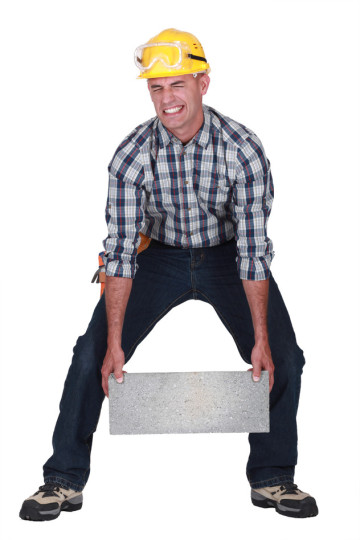 photodune-2664212-man-struggling-to-carry-building-block-s1.jpg