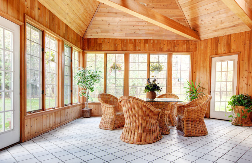photodune-924987-wooden-wall-sun-room-interior-with-wicker-furniture-s.jpg